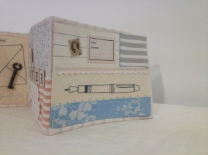 Pens are some of my absolute favourite imagery, and this embroidered one caught my attention in this concertina book.